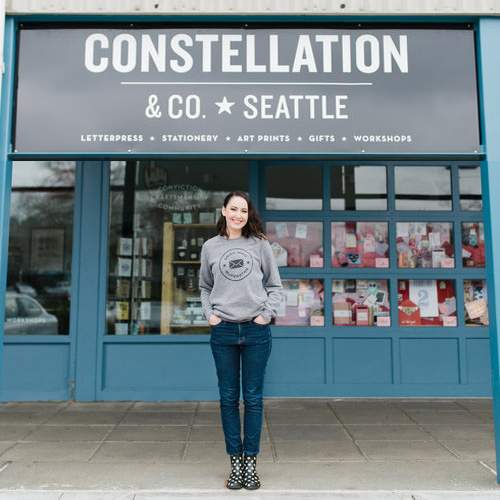 woman standing in front of storefront