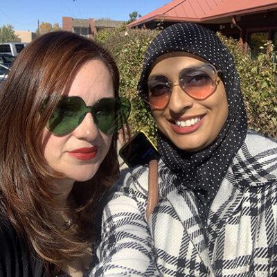 two women in heart-shaped sunglasses